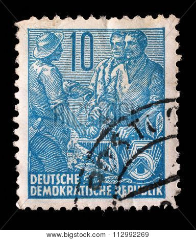 GDR - CIRCA 1955: A stamp printed in GDR, shows Farmer, worker, intellectuals, series Five-year plan, circa 1955