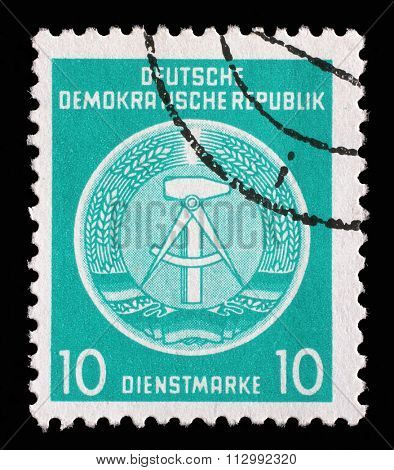GDR - CIRCA 1952: A Stamp printed in GDR (German Democratic Republic - East Germany) shows DDR national coat of arms with inscription Service Stamp, series GDRs national coat of arms, circa 1952