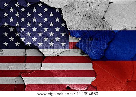 Flags Of Usa And Russia Painted On Cracked Wall