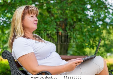 Female 50 Years, Relaxing In The Park On Fresh Air