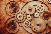 Steampunk background from mechanical clocks details over old metal background. Inside the clock, gears poster