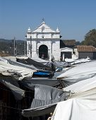 famous church of santo thomas chichicastenango guatemala central america outdoor native market covered with tarps poster