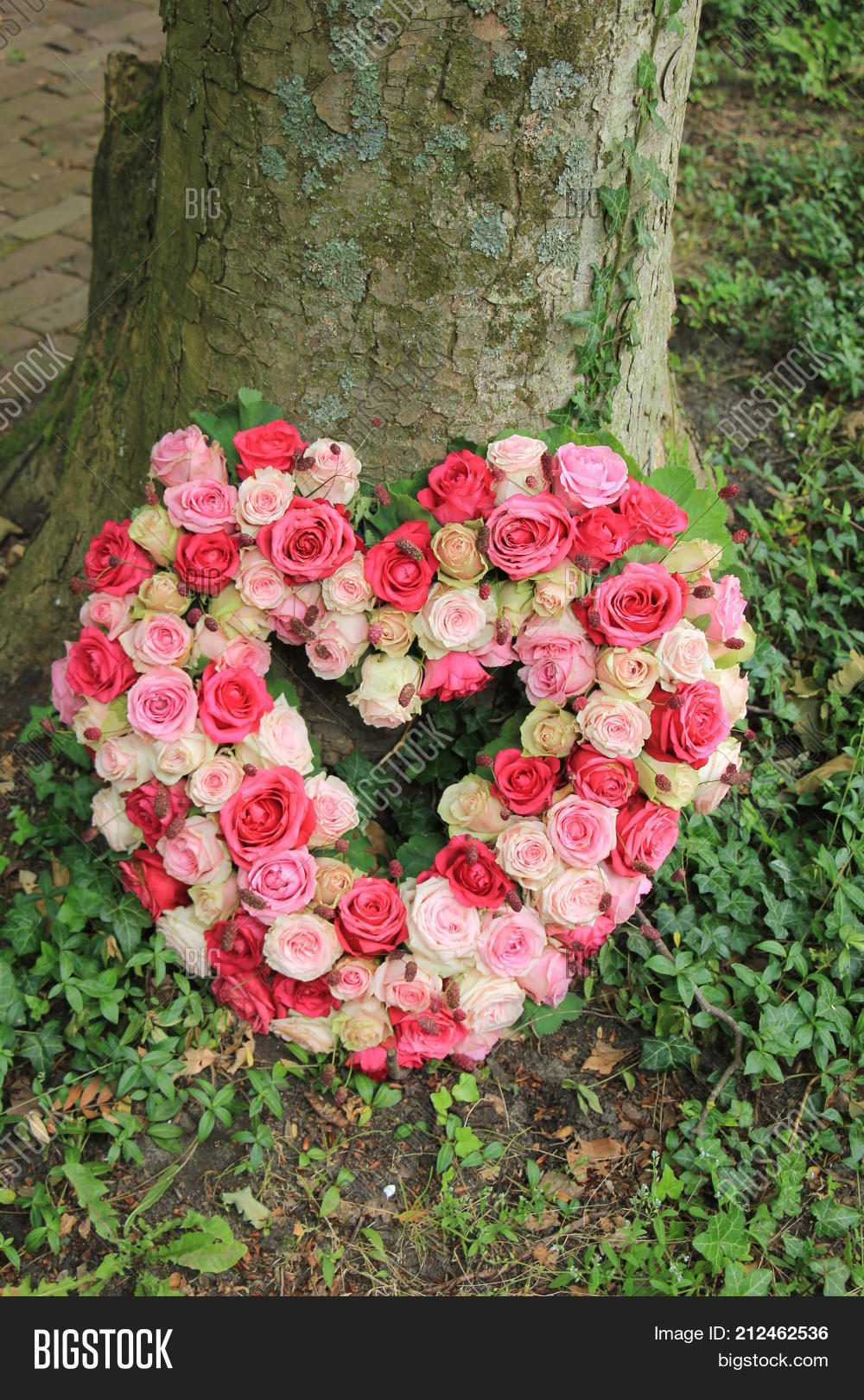 Heart shaped sympathy image photo free trial bigstock heart shaped sympathy flowers or funeral flowers near a tree izmirmasajfo
