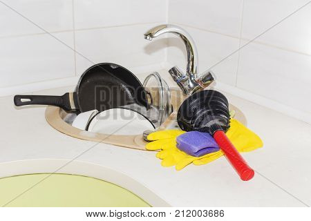 Clog in kitchen sink, obstruction of water, clog pipes