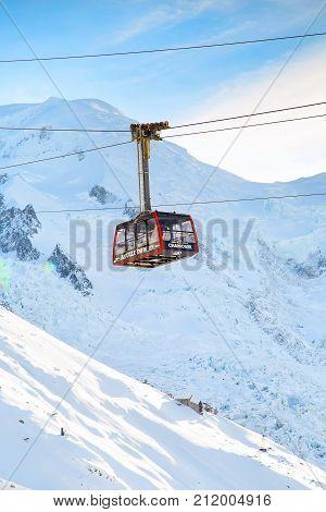 Chamonix, France - January , 28, 2015: Cable Car Telepherique Auguille du Midi and snow mountains