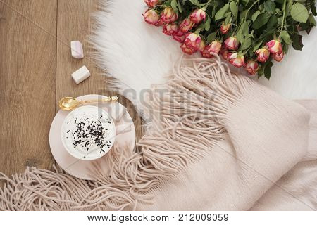 Cozy Winter Mornings. Cappuccino, Bouquet Of Roses And A Warm Scarf On A White Fur Carpet On The Flo