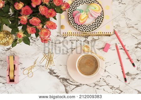Feminine Workplace Concept. Freelance Workspace In Flat Lay Style With Coffee, Flowers, Golden Pinea