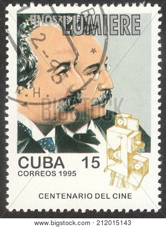 MOSCOW RUSSIA - CIRCA OCTOBER 2017: a post stamp printed in CUBA shows a portrait of Lumiere Brothers the series