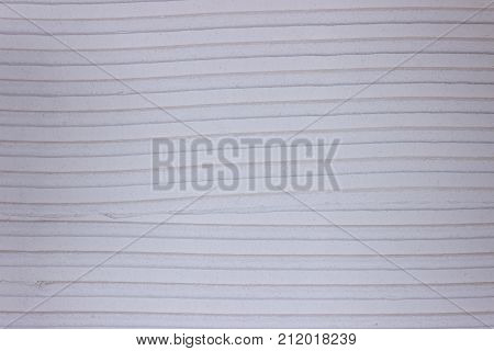 Tile adhesive notched trowel patterns. Adhesive background.