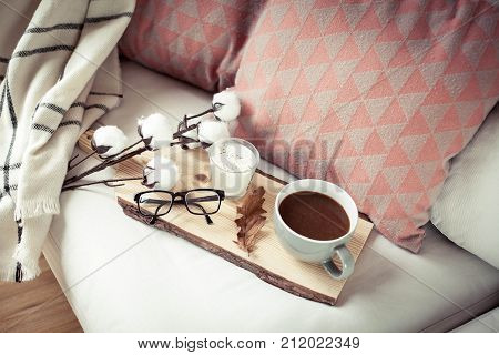 Autumn Cozy Breakfast. Romantic Breakfast. Cotton, A Cup Of Hot Coffee, A Candle, A Plaid, Glasses.