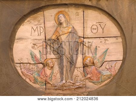 LUCCA, ITALY - JUNE 03: Virgin Mary relief on the facade in Lucca, Tuscany, Italy on June 03, 2017.