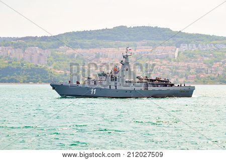 Portoroz, Slovenia - May 27 2011: Slovenian Armed Forces Navy Ship Triglav on patrol in the bay of Piran. The Patrol boat is Russian built Svetlyak class.