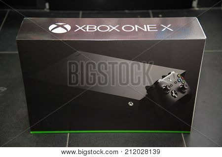 London, november 11, 2017: New Xbox One X console box on black floor covering