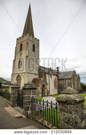 an old irish church with steeple and railings