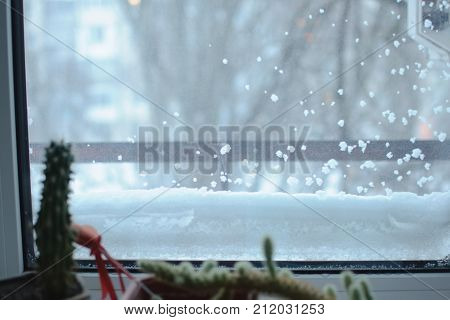 Snowbound Window Close-up, Indoor. Seasonal Winter Weather Conditions. Snowy Winter Background