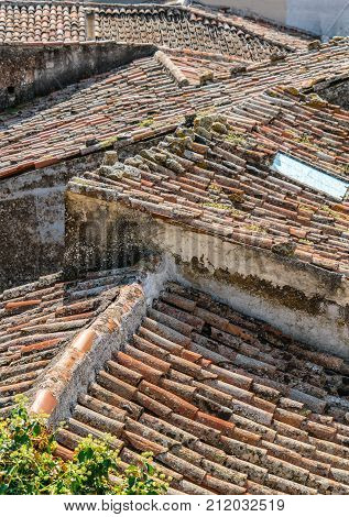 View across ancient roof tops Castiglione di Sicilia Sicily Italyfeaturing rustic terracotta tiles random angles