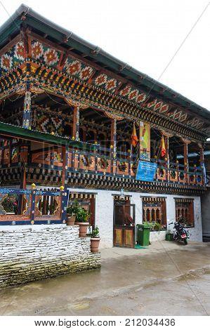 Trongsa Bhutan - September 12 2016: Bhutanese cellco building on a rainy day. TashiCell is a private telecom operator in Bhutan.
