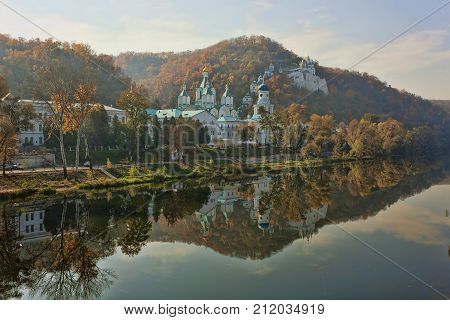 Autumn landscape. Svyatogorsk Lavra with reflection in the water of the river Seversky Donets