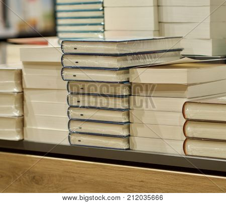 pile of books in a bookstore for sale