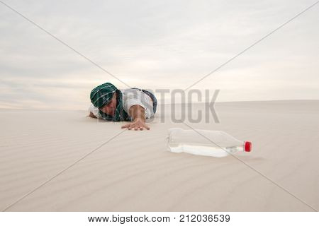 Exhausted Man Crawls In The Desert
