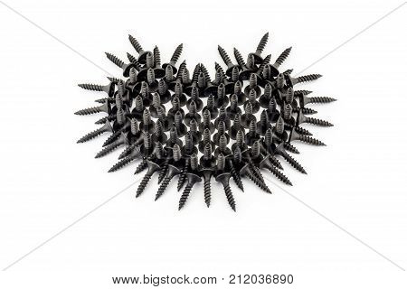 Favorite Men's Activities. Black Heart With Thorns Laid Out Whit Black Screws On White Background