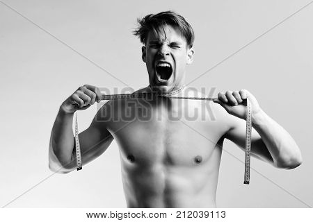 Screaming Man With Blue Measuring Tape On Light Purple Background