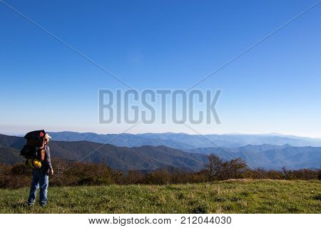 Hiker overlooking the appalachian mountains stretching into the distance