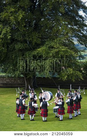 Stirling Scotland - August 17 2010: Band of pipers playing in a garde at the Stirling Castle in Stirling Scotland United Kingdom