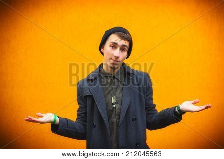 Closeup Portrait Of Dumb, Clueless Young Man, Student, Worker Arms Out Asking What's The Problem