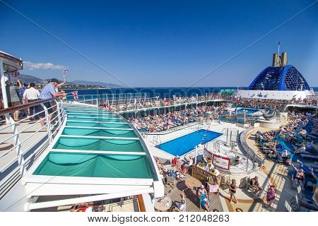 MONACO - 3 April 2017: Sail away party on board the top deck of P&O Oceana as it leaves Monaco.