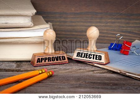 approved and rejected. Rubber Stamp on desk in the Office. Business and work background.