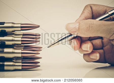 Pen vs. Bullet. Freedom of the press is at risk concept. World press freedom day concept