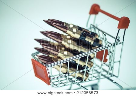 Rifle bullets on a shopping cart / Illegal weapon sold online in underground market concept