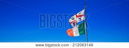 Flag Of Sardinia On The Beach, Sardinia, Italy, Europe.