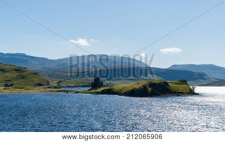 Typical Scottish Highlands lake landscape with a ruined castle and mountains - Highlands, Scotland, UK