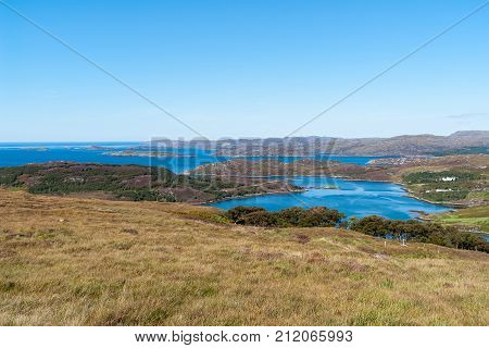 Typical Scottish Highlands seascape with islands ans isolated houses - Western Highlands, Scotland, UK