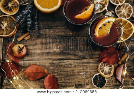 Hot Mulled Wine With Dry Orange Slices, Lavender And Cinnamon Sticks On Wooden Board. Christmas Or W