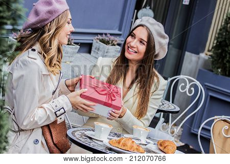 Pleasant Moments With Friend. Receiving Presents.