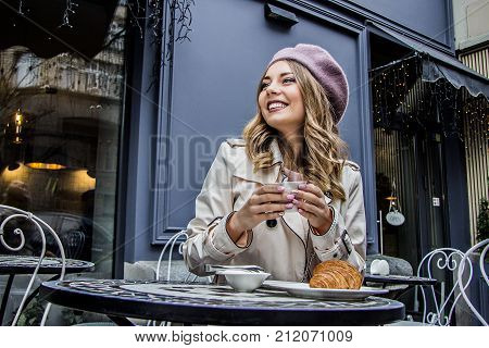 Cheerful French Woman. Woman Drinking Coffee.