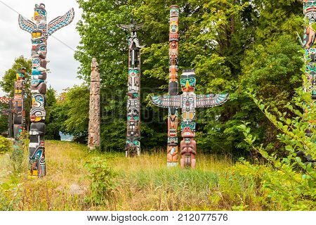 Vancouver August 2015 Indian totems that visitors can admire at stanley park in Vancouver to appreciate the skill of craftsmen who carved them on the wood