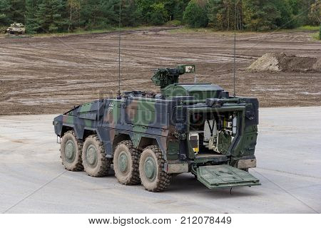 MUNSTER / GERMANY - OCTOBER 9 2017: German GTK Boxer infantry version from Kmw and Rheinmetall stands on a platform near battlefield