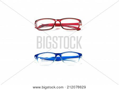 Red and blue spectacles isolated on white background. Glasses model. Fashion accessories collection.
