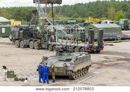MUNSTER / GERMANY - OCTOBER 9 2017: logistics from german army works on a main battle tank Leopard at an exercise