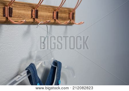 Close-up of dungaree hanging on hook