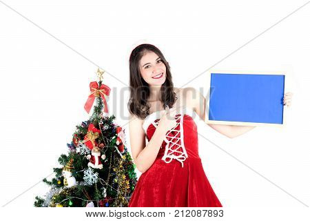 beautiful santa girl wearing santa claus clothes costume holding bare board and christmas tree over white background , happy new year - Christmas concept