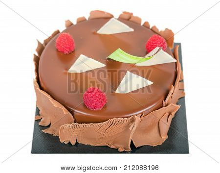 Chocolate cake with berries isolated on white background