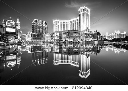 Macau, China - December 8, 2016: iconic The Venetian Macao reflecting on the lake, the largest casino in the world and the largest single structure hotel building in Asia. Black and white shot.