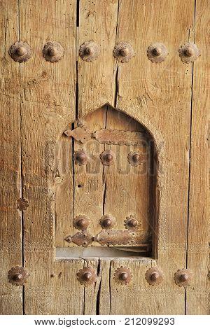 Part of the ancient wooden door with carving, Bukhara, Uzbekistan
