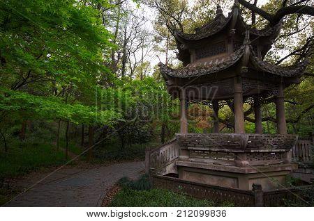Stone pavilion in the chinese garden. Hangzhou, China