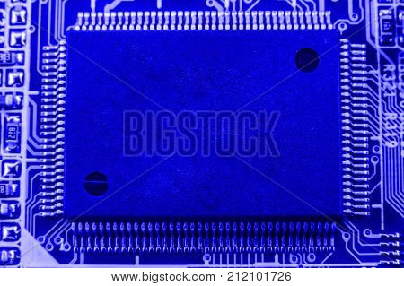 Integrated Semiconductor Microchip On Blue Circuit Board Representative Of The High Tech Industry An